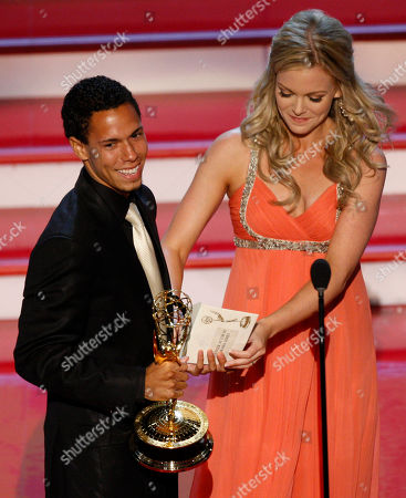 """Bryton McClure;Martha Madison Actor Bryton McClure accepts the Emmy for """"Outstanding Younger Actor in a Drama Series"""" for his work in """"The Young and the Restless"""" from actress Martha Madison at the 34th Annual Daytime Emmy Awards in Los Angeles"""