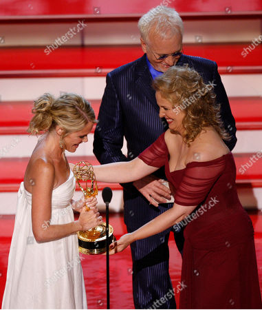"""Anthony Geary;Genie Francis;Maura West Genie Francis presents the Emmy for """"Outstanding Lead Actress in a Drama Series"""" to Maura West at the 34th Annual Daytime Emmy Awards in Los Angeles, . In background is Anthony Geary"""