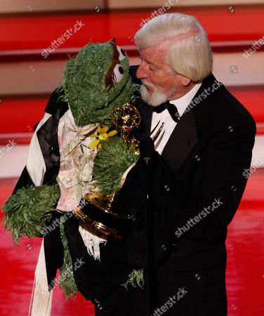"Caroll Spinney, with ""Oscar the Grouch,"" accept the Emmy for ""Outstanding Performer in a Children's Series"" at the 34th Annual Daytime Emmy Awards in Los Angeles"