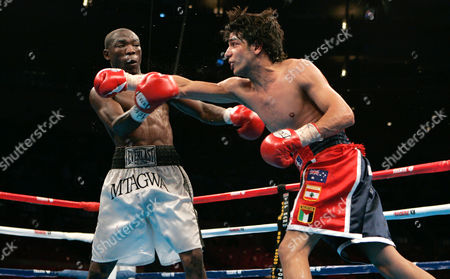 Billy Dib, Rogers Mtagwa Billy Dib, right, and ROgers Mtagwa spar during the WBA super featheweight boxing match, at Madison Square Garden in New York