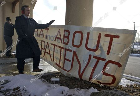Marty Beatty, David Batman Marty Beatty and David Batman, both former patients at the Schneider Medical Clinic in Haysville, Kan., hang a sign in front of the clinic in protest of the arrest of Dr. Stephen Schneider and his wife Linda