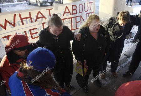 Jennifer Ralstin Jennifer Ralstin says a prayer with other former patients of the Schneider Medical Clinic in Haysville, Kan., as they rally to create awareness of the patients affected by the arrest of Dr. Stephen Schneider and his wife Linda