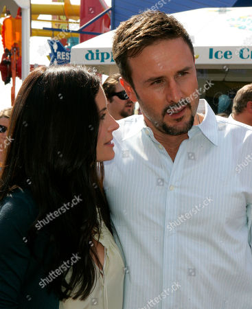 """Courtney Cox;David Arquette Actors Courtney Cox and David Arquette are seen at a fundraising party, """"CelEBration on the Pier,"""" hosted by Courteney Cox and her husband David Arquette, to benefit the EB Medical Research Foundation, on the Santa Monica, Calif., Pier . EB, or Epidermolysis Bullosa, is a rare genetic disease where the skin blisters at the slightest touch"""