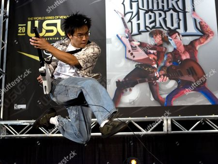 """Freddie Wong Freddie Wong, 21, of Seattle, Wash., plays Guitar Hero II on stage at the World Series of Video Games, in Grapevine, Texas. After a five year absence, """"Guitar Hero"""" and """"Rock Band"""" are planning a reunion tour in 2015 on the current generation of video game consoles. While the new rendition of """"Guitar Hero"""" is offering a revamped controller, """"Rock Band"""" is promising backward compatibility"""