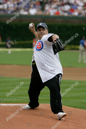 """Stock Image of Joe Gannascoli Actor Joe Gannascoli, from the HBO series """"The Sopranos"""", throws out the ceremonial first pitch at a Chicago Cubs baseball game against the San Francisco Giants in Chicago"""