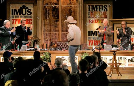 Don Imus, Bernard McGuirk, Rob Bartlett, Charles McCord, Tony Powell Don Imus, center, gets a stading ovation after he addressed the audience at New York's Town Hall during his return to radio Monday morning . Imus returned to the airwaves Monday eight months after he was fired for a racially charged remark about the Rutgers women's basketball team. From left are: Rob Bartlett, Charles McCord, Bernard McGuirk and Tony Powell, members of his program