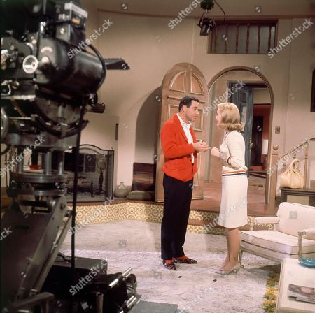 "Stock Image of Actor Jack Lemmon, left, in a scene with actress Carol Lynley during the filming of movie ""Under the Yum Yum Tree"" in Hollywood, California, in April of 1963"