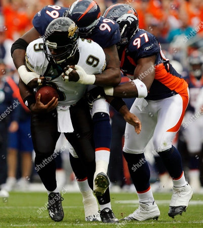 David Garrard; Alvin McKinley; Simeon Rice Jacksonville Jaguars quarterback David Garrard, front, is sacked by Denver Broncos defensive tackle Alvin McKinley, back left, and defensive end Simeon Rice in the first quarter of the Jaguars' 24-13 victory in a football game in Denver on