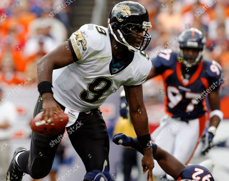 Stock Picture of Simeon Rice; David Garrard Jacksonville Jaguars quarterback David Garrard (9) eludes Denver Broncos defensive end Simeon Rice in the second quarter of the Jaguars' 24-13 victory in a football game in Denver on