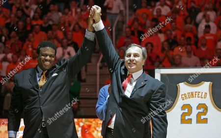 Ernie Grunfeld, Bernard King Former Tennessee players Ernie Grunfeld, right, and Bernard King share a moment during halftime of a college basketball game against Kentucky, in Knoxville, Tenn. Grunfeld's jersey was being retired