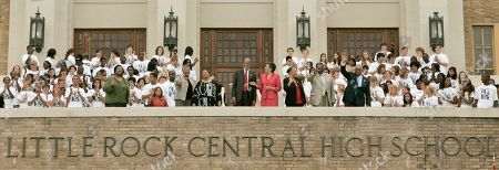 Melba Patillo Beals, Thelma Mothershed Wair, Minnijean Brown Trickey, Elizabeth Eckford, Terrence Roberts, Carlotta Wallls LaNier, Gloria Ray Karlmark, Jefferson Thomas, Ernest Green The Little Rock Nine, from left front row, Melba Pattillo Beals, Thelma Mothershed Wair, seated, Minnijean Brown Trickey, Elizabeth Eckford, Terrence Roberts, Carlotta Wallls LaNier, Gloria Ray Karlmark, Jefferson Thomas, and Ernest Green wave as they are applauded by Little Rock Central High School students on the steps of the school in Little Rock, Ark., after 50th anniversary observances, of when the nine integrated the school