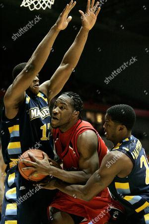 John Williamson, Dwight Burke, Wesley Matthews Cincinnati forward John Williamson, center, is trapped by Marquette defenders Dwight Burke, left, and Wesley Matthews, right, in a college basketball game, in Cincinnati