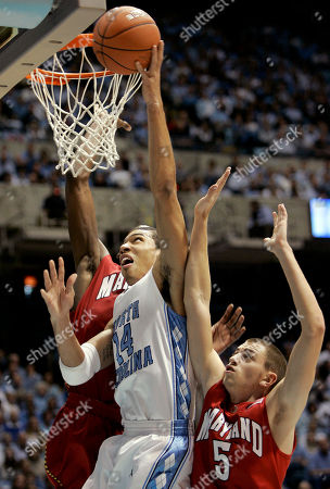 Danny Green, Eric Hayes, James Gist North Carolina's Danny Green (14) drives between Maryland's Eric Hayes (5) and James Gist during the first half of a college basketball game in Chapel Hill, N.C
