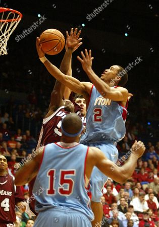 Dayton's Brian Roberts (2) goes to the basket against Massachusetts Ricky Harris (5) during the second half of a basketball game played Wed., in Dayton, Ohio. Also shown is Dayton's Charles Little (15). No. 14 Dayton fell to Massachusetts 82-71