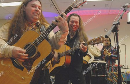 Paul Pike; George Newton; Steven Alvarez Medicine Dream band members from left, Paul Pike, George Newton and Steven Alvarez provide a mix of traditional and rock music during an event in Anchorage, Alaska