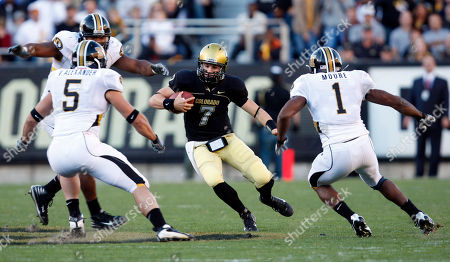 Cody Hawkins, Van Alexander, William Moore No.9-Missouri linebacker Van Alexander, left, and safety William Moore, right, close in for a tackle on Colorado quarterback Cody Hawkins in the first quarter of a Big-12 Conference college football game in Folsom Field in Boulder, Colo., on