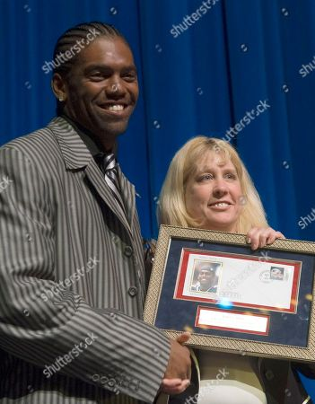 Randy Moss, Schenck New England Patriots wide receiver Randy Moss, left, receives a U.S. Postal Service envelope with his likeness from Karen Schenck, of the postal service, at the West Virginia Cultural Center in Charleston, W.Va., . Moss is the third West Virginia athlete to be on a special Postal Service envelope. The others were Los Angeles Lakers' Jerry West and gold-medal Olympic gymnast Mary Lou Retton