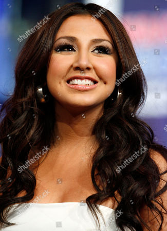 "Stock Photo of Aundrea Fimbres Aundrea Fimbres, of the band Danity Kane, appears onstage during MTV's ""Total Request Live"" at the MTV Times Square Studios in New York. Danity Kane's latest album ""Welcome to the Dollhouse"" hit stores Tuesday"