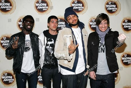 "Disashi Lumumba-Kasongo; Eric Roberts; Travis McCoy; Matt McGinley From left, Disashi Lumumba-Kasongo, Eric Roberts, Travis ""Schleprok"" McCoy and Matt McGinley of Gym Class Heroes arrive at the mtvU Woodie Awards in New York"