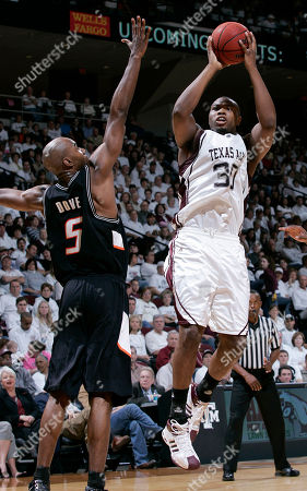 Joseph Jones, Marcus Dove Texas A&M's Joseph Jones (30) shoots over Oklahoma State's Marcus Dove during the first half of a basketball game, in College Station, Texas