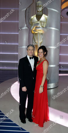Jon Stewart; Tracey McShane Host Jon Stewart and his wife Tracey McShane pose on stage following the 80th Academy Awards in Los Angeles