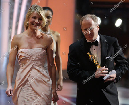 """Cameron Diaz; Robert Elswit Actress Cameron Diaz, left, leaves the stage with Robert Elswit after presenting him with the Oscar for achievement in cinematography for his work on """"There Will Be Blood"""" during the 80th Academy Awards in Los Angeles"""