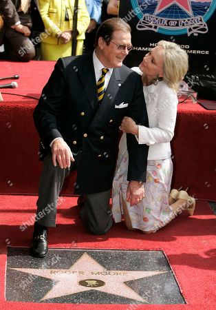 Roger Moore,Christina Tholstrup Actor Roger Moore, who played the part of James Bond 007 in seven films, is seen with his wife Christina Tholstrup, during a ceremony honoring him with a star on the Hollywood Walk of Fame, in the Hollywood section of Los Angeles. Moore's star is aptly located at 7007 Hollywood Blvd