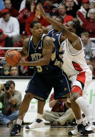 Tyrell Biggs, John Williamson Pittsburgh forward Tyrell Biggs (5) is pressured by Cincinnati forward John Williamson during a college basketball game, in Cincinnati