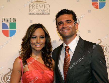Satcha Pretto Satcha Pretto, left, and guest on the red carpet for the Premio Lo Nuestro Latin Music Awards in Miami Thursday, Feb.21, 2008