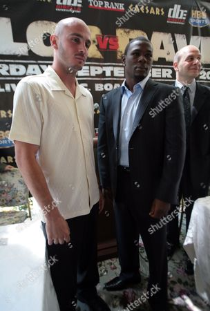 Kelly Pavlik, Jermain Taylor Undefeated challenger Kelly Pavlik, left, and undefeated world middleweight champion Jermain Taylor at a press conference in New York, . Taylor will defend the title against Pavlik in a championship fight Saturday September 29, in Atlantic City, New Jersey. Lou DiBella is in background on right