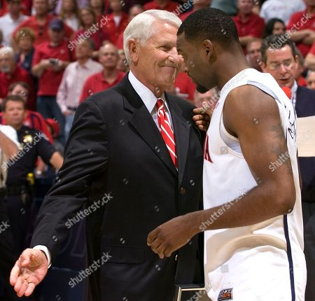 Lute Olson Arizona's head coach Lute Olson, who is on a leave of absence is on hand today to say farewell to his senior, Jawann McClellan right, after the game against UCLA at McKale Center in Tucson, Ariz., . UCLA won, 68 - 66