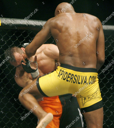 Anderson Silva, Rich Franklin Rich Franklin, left, is knocked out with a knee to the face from Anderson Silva, right, in the second round of their UFC middleweight title fight in Cincinnati