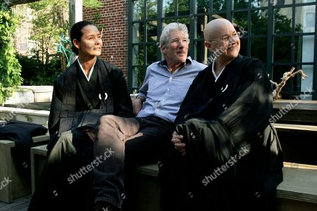 Stock Image of Richard Gere Actor Richard Gere, center, discusses Tibetan Buddhism with, from left to right, Sonja Nuttall and Zen Master Roshi Pat O'Hara at Donna Karan's Urban Zen Initiative. The Urban Zen Initiative is a wellness forum aimed at merging Eastern and Western medicine in order to improve patient care, in New York City