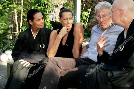 Stock Photo of Richard Gere Actor Richard Gere, center, discusses Tibetan Buddhism with, from left to right, Sonja Nuttall, Donna Karan and Zen Master Roshi Pat O'Hara at Donna Karan's Urban Zen Initiative. The Urban Zen Initiative is a wellness forum aimed at merging Eastern and Western medicine in order to improve patient care, in New York City