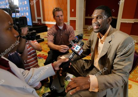 Greg Oden Basketball player Greg Oden, right, of Ohio State University, interviews with reporters after a news conference in Las Vegas, . Oden officially joined the USA Basketball senior national team Wednesday
