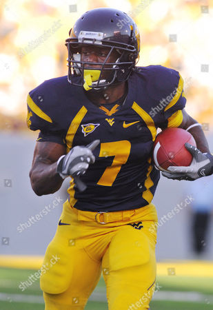 Noel Devine West Virginia's Noel Devine carries the ball against Western Michigan during the second half of a college football game, in Morgantown, W.Va