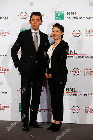 Director Miwa Nishikawa, right, and actor Masahiro Motoki pose for photographers during a photo call for the movie 'Nagai Iiwake' (The Long Excuse) at the Rome Film festival, in Rome