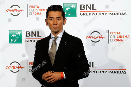 Actor Masahiro Motoki poses for photographers during a photo call for the movie 'Nagai Iiwake ' (The Long Excuse), at the Rome Film festival in Rome