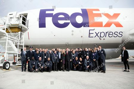 CEO and President of Fedex Express David Bronczek and US ambassador to France Jane Hartley pose on the tarmac of the Roissy Charles de Gaulle Airport for the presentation of the future extension hub of FedEx in the North of Paris