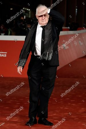 Director Jim Sheridan poses for the photographers as he arrives on the red carpet on the occasion of the screening of the movie ' The Secret Scripture ' at the Rome Film festival in Rome