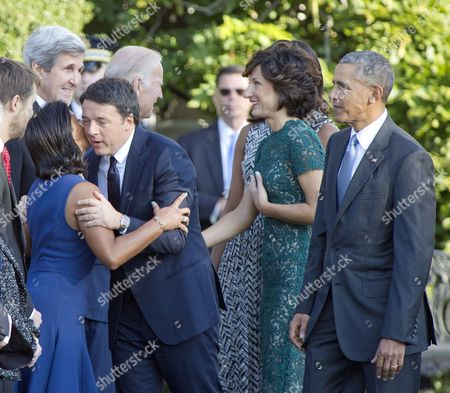 Prime Minister Matteo Renzi of Italy hugs United States National Security Advisor Susan Rice as US Vice President Joe Biden greets Agnese Landini prior to the arrival ceremony at the start of an Official Arrival Ceremony on the South Lawn of the White House US President Barack Obama looks on from right.