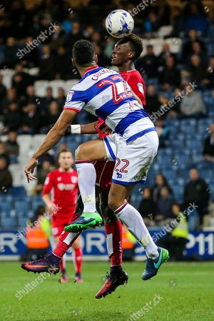 Tammy Abraham of Bristol City is challenged by Steven Caulker of Queens Park Rangers as he attempts a headed shot