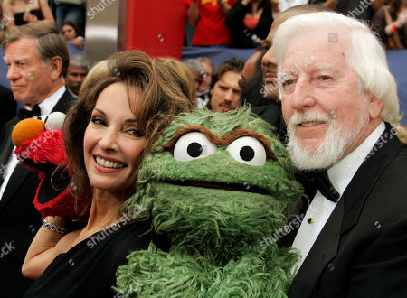 "Susan Lucci, Caroll Spinney Actress Susan Lucci, of the television series ""All My Children,"" poses with the Sesame Street puppets Oscar the Grouch and Elmo, left, and puppeteer Caroll Spinney, right, as they arrive at the 33rd Annual Daytime Emmy Awards in Los Angeles on"