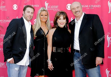 Dr. Phil McGraw From left, Jay McGraw, wife Erica Dahm, Robin McGraw and Dr. Phil McGraw arrive at the 42nd Annual Academy of Country Music Awards, in Las Vegas