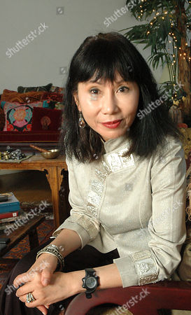 Author Amy Tan poses in her apartment in Manhattan's Soho district