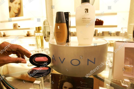 Made Nov. 15, 2005, a saleswoman, who did not give her name, places items for a picture on display in an Avon store in New York. Avon Products Inc. says it has tapped one-time Johnson & Johnson executive Sherilyn S. McCoy as its new CEO as the struggling beauty products company looks to regain its past luster, according to reports . McCoy will take over the post from Andrea Jung, who will stay on as executive chairman