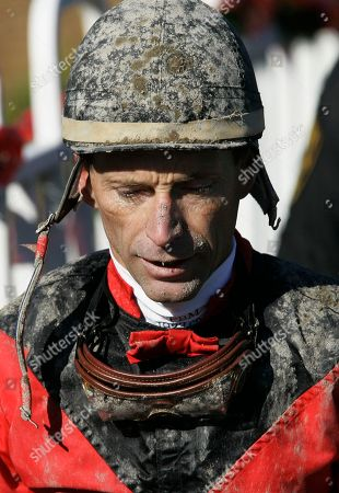Russell Baze Jockey Russell Baze walks off after the first race at Bay Meadows in which he finished fourth in San Mateo, Calif., . Baze won the fourth race for his 9,531st victory to eclipse Laffit Pincay Jr.'s career record