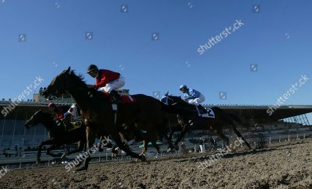 Russell Baze Jockey Russell Baze, foreground, rides Mr. Frodo during the first race, in which he finished fourth, at Bay Meadows in San Mateo, Calif., . Baze rode Butterfly Belle to win the fourth race for his 9,531st career victory to eclipse Laffit Pincay Jr.'s record