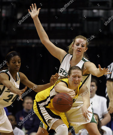 SKOUBY Michigan State's Rene Haynes, left, and Laura Hall, top right, force a turnover by Iowa's Megan Skouby during the first half of a second round basketball game in the Big Ten Conference tournament in Indianapolis