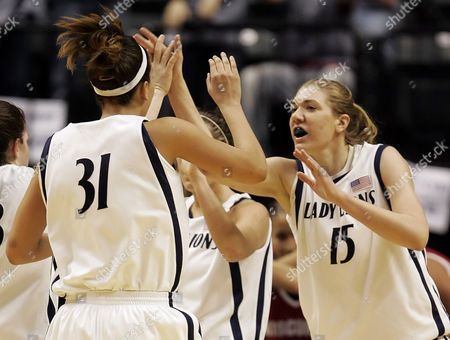 BROWN REDFRO Penn State's Amanda Brown (15) and Charity Renfro (31) react after Brown made a shot and got fouled by Wisconsin during the second half of an opening round basketball game in the Women's Big 10 tournament in Indianapolis, . Penn State defeated Wisconsin, 80-73